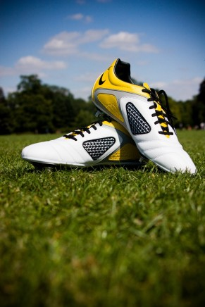Photo of two football boots on grass